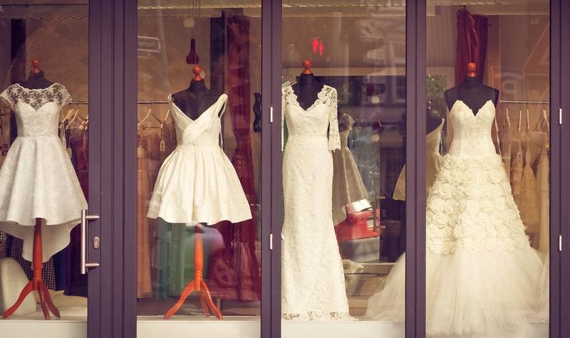 wedding dresses in a window