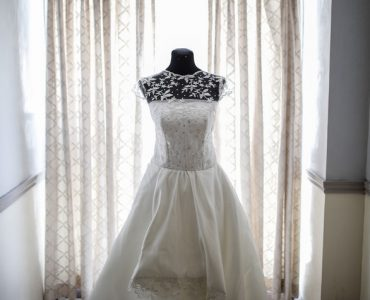 wedding dress in front of curtains