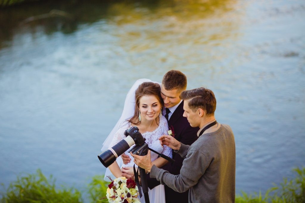 wedding photographer talking to couple