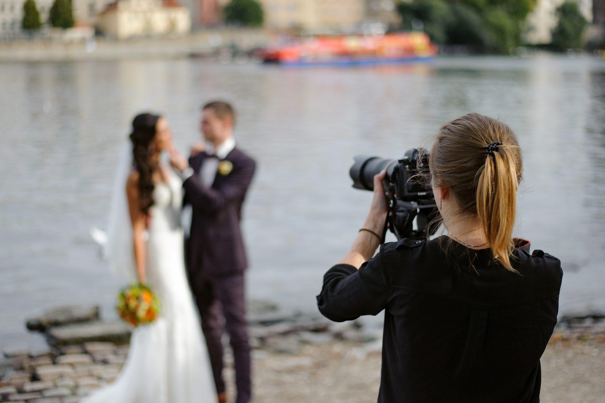 female wedding photographer shooting a wedding