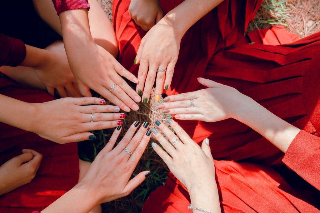 girls wearing rings