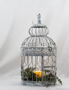 vintage birdcage with candle