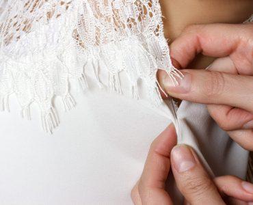 wedding dress being altered