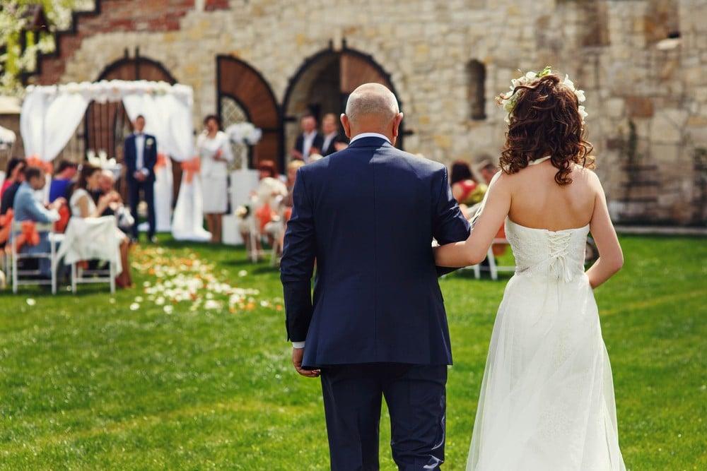 father escorting bride