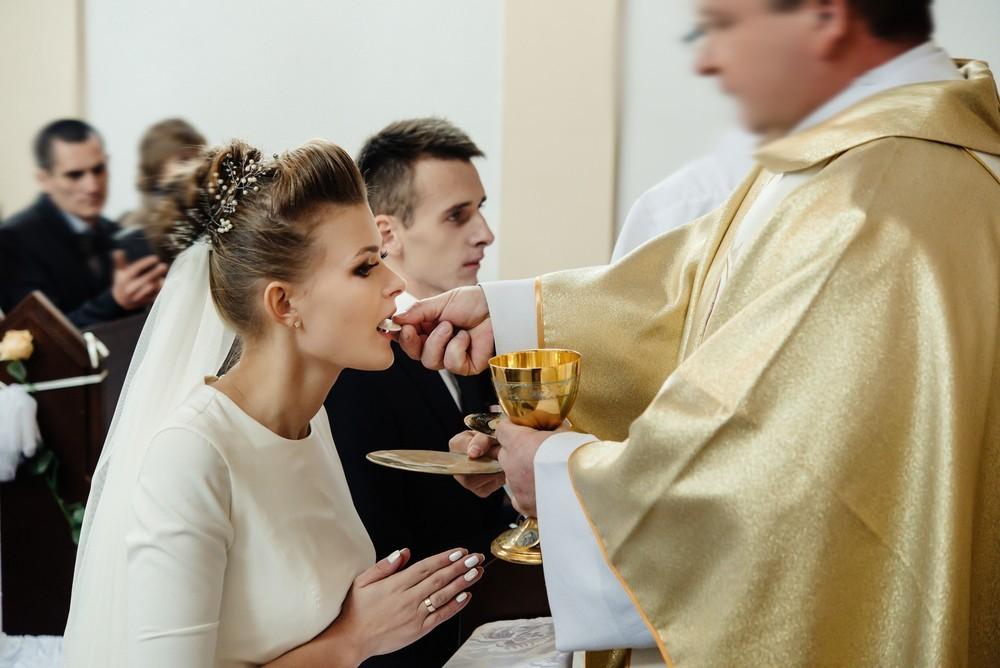 bride eating eucharist